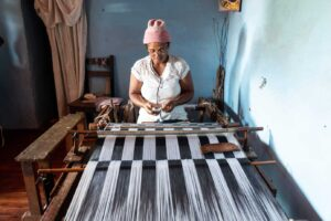 Hand loom and woman